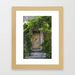 Provence Door covered with green vines Framed Art Print