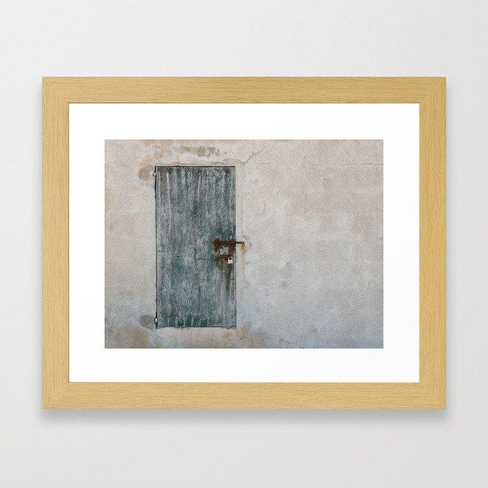 Blue-green door on a concrete wall in Mallorca Framed Art Print