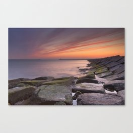 II - Sunset over harbour entrance at sea in IJmuiden, The Netherlands Canvas Print
