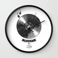 onesie Wall Clocks featuring music is ...life  (vintage version) by mauro mondin