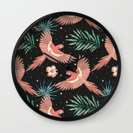 Pink macaw parrots on the starry night sky Wall Clock