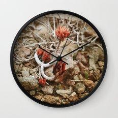 Fleur du désert Wall Clock
