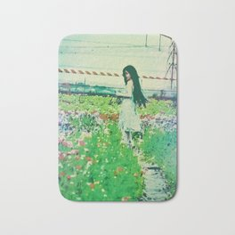"""A Flower Does Not Think Of Competing To The Flower Next To It. It Just Blooms"" Bath Mat"