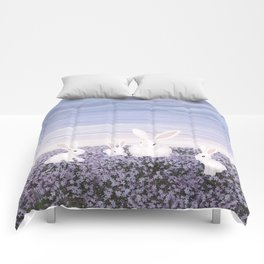 white rabbits and purple flowers Comforters