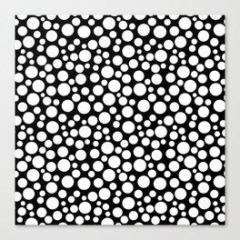 White polka dots on a black background. Canvas Print