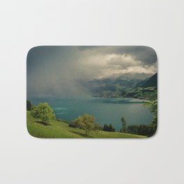 arising storm over lake lucerne Bath Mat