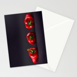 Red peppers on a black background Stationery Cards
