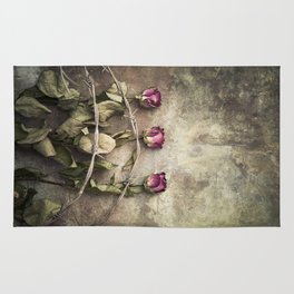 Three dried roses and barbed wire Rug