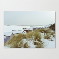 Sand dunes and beach huts in snow. Wells-next-the-sea. Canvas Print
