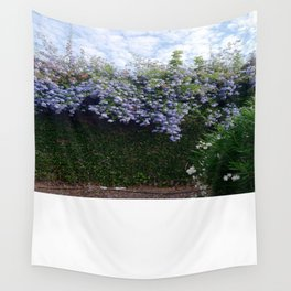 Blue flowers and skies Wall Tapestry