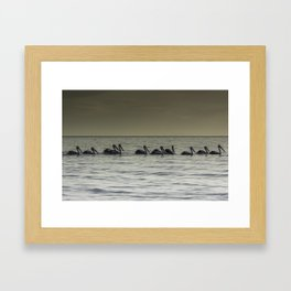 All in a row. Framed Art Print