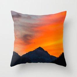 Stunning vibrant sunset behind mountain Throw Pillow