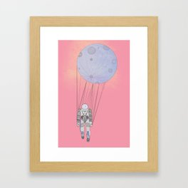 The Moon-Man Floating Through the Pink Universe Framed Art Print