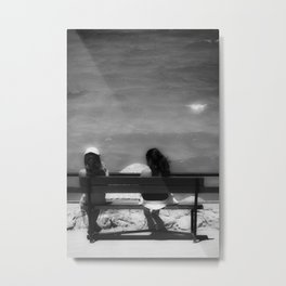 Two girls sitting on a bench at sea side Metal Print