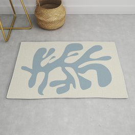 Leaf cut out in blue Rug