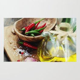 fresh  herbs  with  mezzaluna, olive oil and vegetables on cutting board Rug