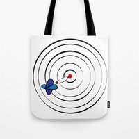 chicago bulls Tote Bags featuring Bulls Eye by Nivedhna