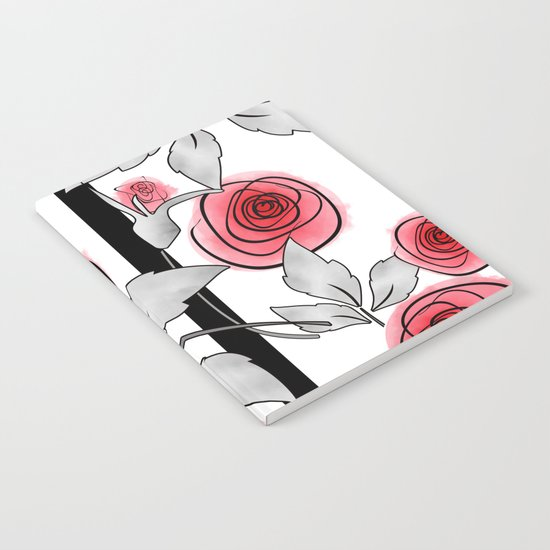 Red roses on black and white striped background. Notebook