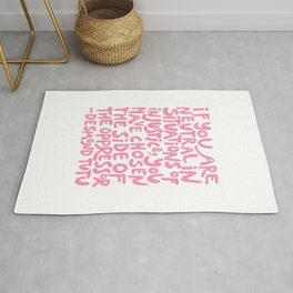 if you are neutral in situations of injustice you have chosen the side of the oppressor (activist quote in groovy pink)  Rug