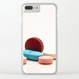 Numerous medicines Medications in the form of tablets. Colored pills on a white background. Clear iPhone Case