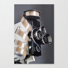 Retro mechanical movie camera and reel film Canvas Print