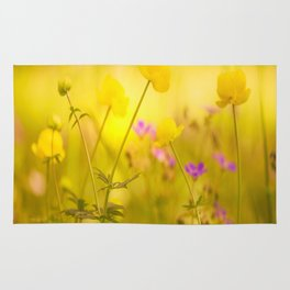 Wild flowers in the golden sunset shades Rug
