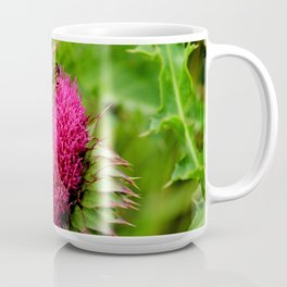 The thistle and a fly Coffee Mug