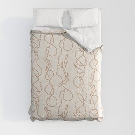 aria flowing faces - gold on cream Comforters