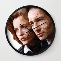 dana scully Wall Clocks featuring Scully and Mulder - The truth is out there by Mandog Designs