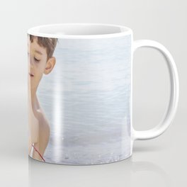 Young boy playing on a beach in French Riviera Coffee Mug