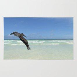 Pelican above the ocean Rug