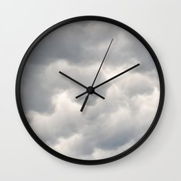 A bunch of rainy clouds Wall Clock