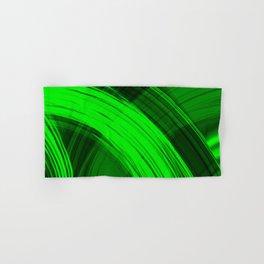 Bright pillars of green light from flowing lines on dark fabric. Hand & Bath Towel