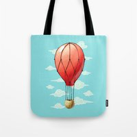 hot air balloon Tote Bags featuring Hot Air Balloon by Freeminds