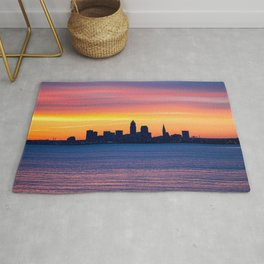 city buildings silhouettes water sunset dark Rug
