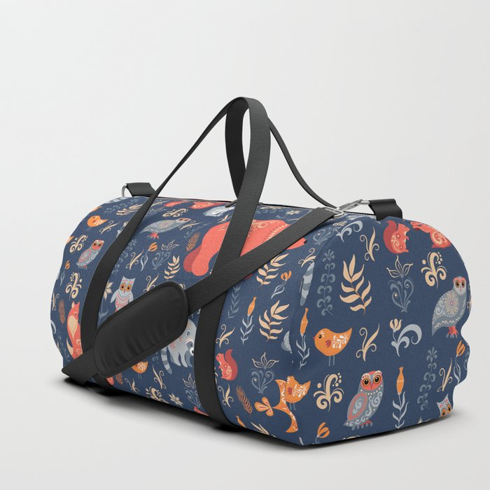 Fairy-tale forest. Fox, bear, raccoon, owls, rabbits, flowers and herbs on a blue background. Seamle Duffle Bag
