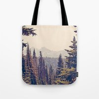 woods Tote Bags featuring Mountains through the Trees by Kurt Rahn