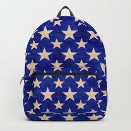 Gold stars on a dark blue background. Backpack
