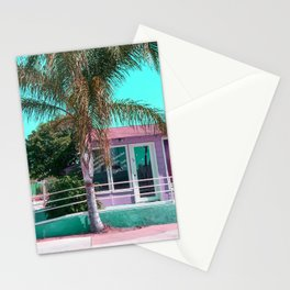 pink building in the city with palm tree and blue sky Stationery Cards