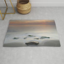 Calm red sunset at the beach Rug
