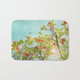 Pink Camellia japonica Blossoms and Sun in Blue Sky Bath Mat