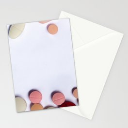 Numerous colorful pills on white background. Stationery Cards