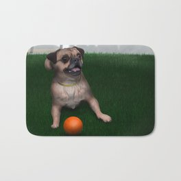 Dog playing with ball in Toronto park Bath Mat