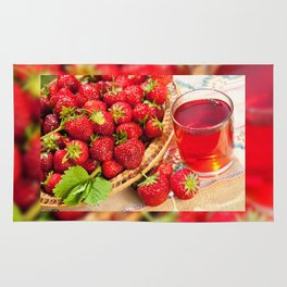 Red strawberries in basket and juice Rug