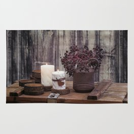 Autumn Still Life with berries and candles Rug