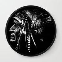 native american Wall Clocks featuring Native American by Sandy Elizabeth