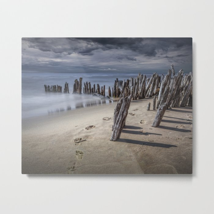 Footprints and Pilings on the Beach at Kirk Park by Grand Haven Michigan Metal Print