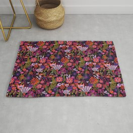 Purple and red flowers with green leaves on a black background. Distressed vintage look. Bright flowers on a dark background. Rug