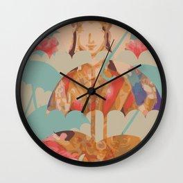 Lakshmi and umbrellas Wall Clock