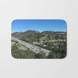 City in mountains, highway passing through Bath Mat